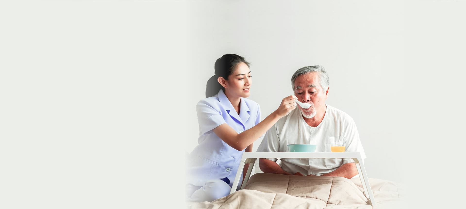 caregiver helping patient to eat