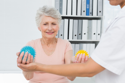 senior patient using stress buster balls